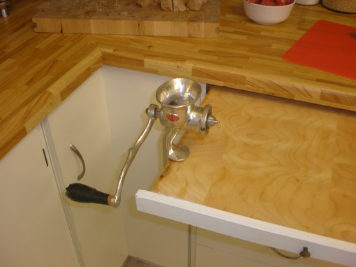 """The meat grinder attached to the """"counter drawer""""."""